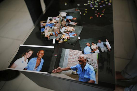 Pictures of Liu Guolian's father Liu Qian, who was a forced labourer by Mitsui Mining to work in their mines in Fukuoka of Japan, are seen on a table