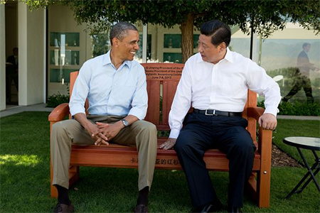 """The President sits with President Xi Jinping of China on an inscribed redwood park bench at the Annenberg Retreat at Sunnylands in Rancho Mirage, Calif. The two leaders spent two days in bilateral talks at Sunnylands."""