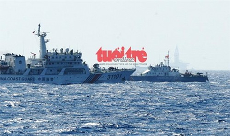A Chinese vessel (L) is seen moving straight toward a Vietnamese ship in this photo taken May 14, 2014