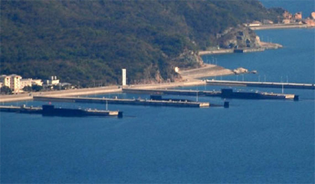 Photo taken by a web user on the spot of three strategic nuclear submarines berthed together