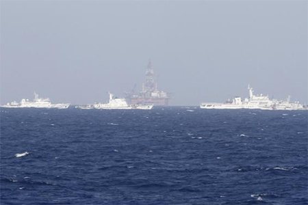 Chinese oil rig Haiyang Shi You 981 is seen surrounded by ships of China Coast Guard in the South China Sea, about 210 km (130 miles) off shore of Vietnam May 14, 2014