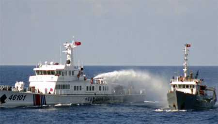 China attacks Vietnamese boat with water cannon