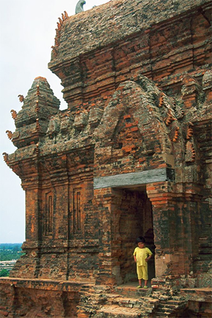 A child stands in the doorway of a Cham temple in south-central Vietnam