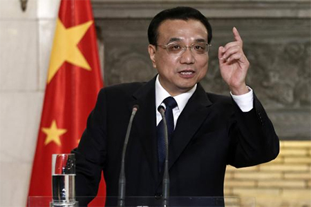 China's Premier Li Keqiang addresses journalists during a joint news briefing with Greek Prime Minister Antonis Samaras (not pictured) in Athens June 19, 2014