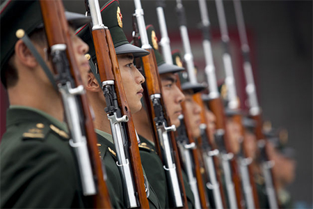 Members of China's People's Liberation Army in Beijing. Under the Military Service Law, males in China can apply to enlist when they reach 18