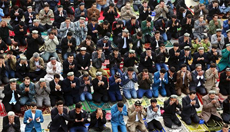 Muslims praying at a mosque in China's western province of Xinjiang