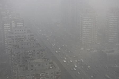 Cars drive on the Three Ring Road amid the heavy haze in Beijing February 26, 2014