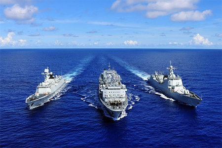 The Chinese missile destroyer Haikou (R), missile frigate Yueyang and supply ship Qiandaohu (C) are seen during the supply at sea in Pacific Ocean, during the the Rim of the Pacific (Rimpac) multinational naval exercises on June 13, 2014