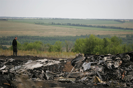 Search and rescue specialists inspect the crash area of Malaysia Airlines flight 17, carrying nearly 300 people from Amsterdam to Kuala Lumpur when it was downed close to Russia's border with Ukraine on July 17, near Grabovo