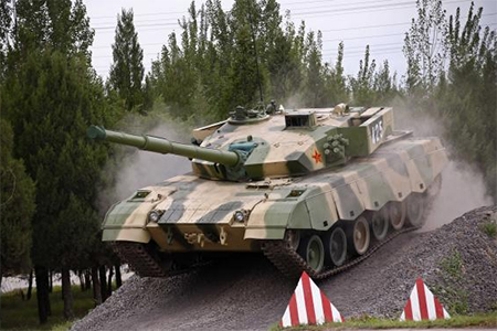 A tank is driven down a slope during an organised media tour at a People's Liberation Army (PLA) engineering academy in Beijing July 22, 2014.