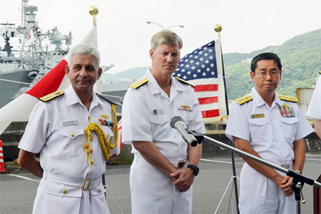 Maritime Self-Defense Force Rear Adm. Hidetoshi Iwasaki (right) joins Indian and U.S. naval officers at a news conference before the start of a weeklong joint exercise in the Pacific Ocean at the U.S. Navy's base in Sasebo, Nagasaki Prefecture, on July 24