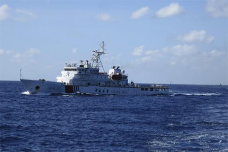 Chinese coastguard ships give chase to Vietnamese coastguard vessels (not pictured) after they came within 10 nautical miles of the Haiyang Shiyou 981, known in Vietnam as HD-981, oil rig in the South China Sea July 15, 2014