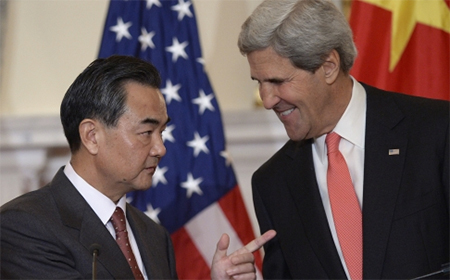 Secretary of State John Kerry (right) sheepishly apologised after Chinese foreign minister Wang Yi (left) pointed out he had waited for half an hour