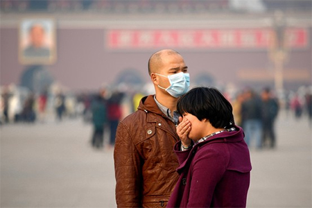 Visitors to Tiananmen Square struggle with Beijing's polluted air, Nov. 5, 2013