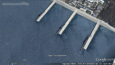 Two 90-odd metre submarines and one approximately 130 metre submarine berthed at the smaller piers. The two submarines are possibly Type 091 SSNs and the larger one is most likely the Jin-class, Type 094 SSBN. The VLS on the 094 are visible.