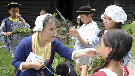 Reba-Jean Shaw-Pichette teaches students from China and other countries how to identify herbs by smell as part of an English immersion summer program in Deerfield, Mass.
