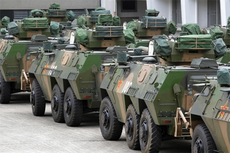 About 20 armored vehicles are seen at PLA Gun Club Hill Barracks.