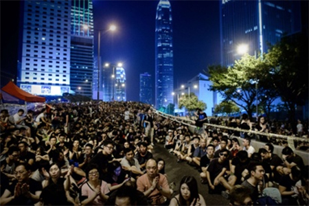 Pro-democracy demonstrators gather for a night rally in Hong Kong last week