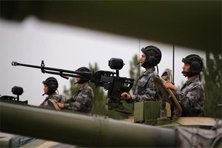 Soldiers of People's Liberation Army (PLA) stand inside tanks at a drill during an organised media tour at a PLA engineering academy in Beijing July 22, 2014