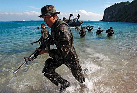 Filipino cadets practice amphibious landing.