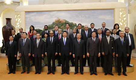 China's President Xi Jinping (C) poses for photos with the guests at the Asian Infrastructure Investment Bank launch ceremony at the Great Hall of the People in Beijing October 24, 2014.