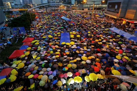 Protesters open their umbrellas, symbols of pro-democracy movement, as they mark exactly one month since they took the streets in Hong Kong's financial central district October 28, 2014.