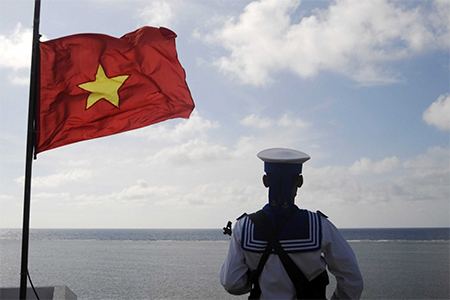 A Vietnamese naval soldier stands quard at Thuyen Chai island in the Spratly archipelago January 17, 2013