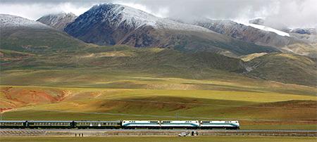 The train travels on the Tibetan grasslands near Lhasa, Tibet.