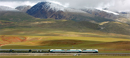 The train travels on the Tibetan grasslands near Lhasa, Tibet.