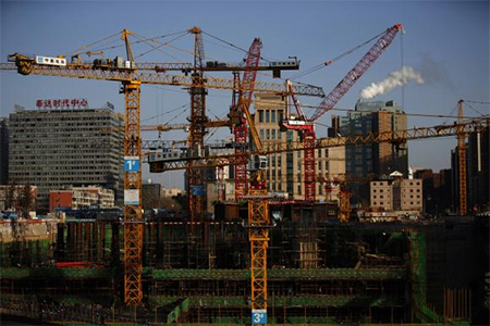 Cranes are seen at a construction site in Beijing