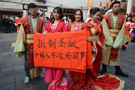"""Students in Changsha, Hunan Province, on Wednesday displayed banners reading """"Resist Christmas. Chinese should not celebrate foreign festivals."""""""