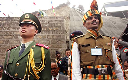 Indian and Chinese soldier in tough posturing.