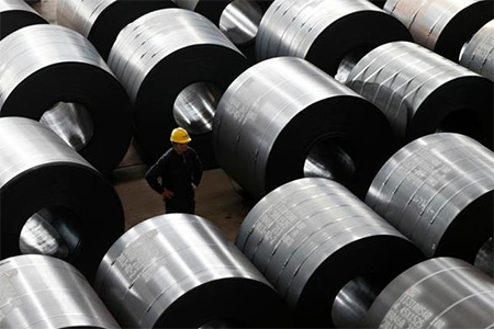 An employee works at a steel factory that exports to Europe and America in Jiaxing, Zhejiang province, in this February 28, 2013 file photo. China appears to have been routinely underestimating output from its sprawling steel sector, with official figures for last year alone 40 million tonnes below a key industry estimate - an amount equivalent to Germany's entire annual production. REUTERS/William Hong/Files