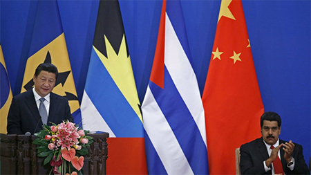 Venezuelan president Nicolas Maduro has good reason to applaud Xi Jinping.