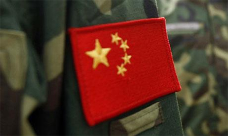 The flag of the People's Republic of China is seen on a People's Liberation Army (PLA) camouflage uniform.