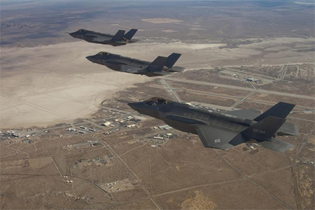 Three F-35 Joint Strike Fighters (rear to front) AF-2, AF-3 and AF-4, can be seen flying over Edwards Air Force Base in this Dec. 10, 2011 handout photo provided by Lockheed Martin.