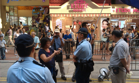 Man and woman interrupted by police, Causeway Bay, Hong Kong