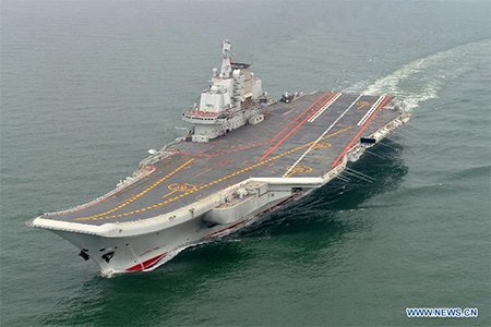 The Chinese aircraft carrier Liaoning sailing without any aircraft.