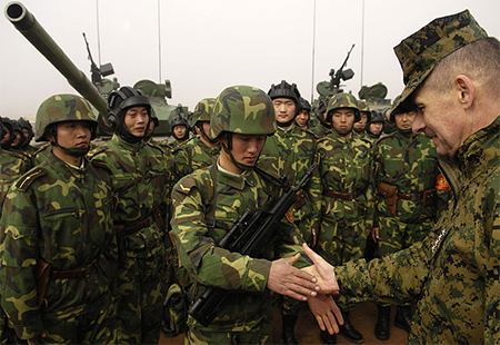 Chairman of the Joint Chiefs of Staff General Peter Pace USMC shakes hands with Chinese tanker soldier with a QBZ-95