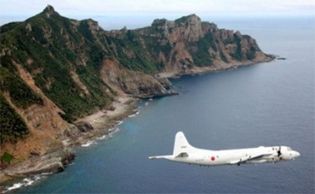 Japan Maritime Self-Defense Force's PC3 surveillance plane flies around the disputed islands in the East China Sea, known as the Senkaku isles in Japan and Diaoyu in China, in this October 13, 2011 file photo. REUTERS