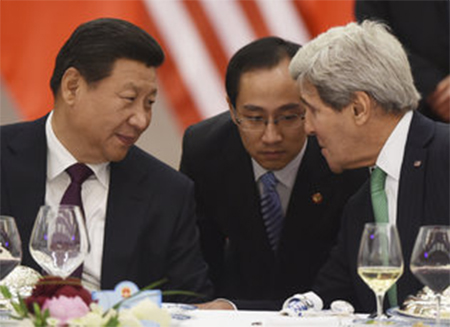 Secretary of State John Kerry with President Xi Jinping of China, left, in Beijing in November.  Trade groups are urging Mr. Kerry and other officials to push back against new Chinese policies.