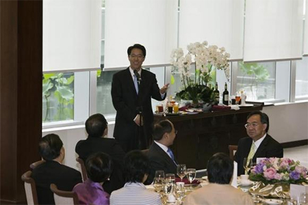 Zhang Xiaoming (C), director of China's Liaison Office, speaks during a lunch meeting at the Legislative Council in Hong Kong July 16, 2013