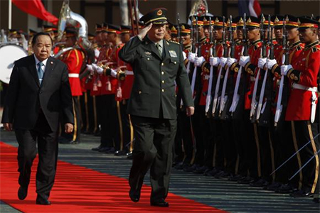 China's Defence Minister Chang Wanquan, accompanied by Thailand's Deputy Prime Minister and Defence Minister Prawit Wongsuwan (L), reviews a guard of honour during his visit to Thailand, at the Defence Ministry in Bangkok February 6, 2015.