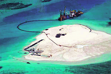 A Chinese vessel expanding land on Johnson South Reef. Manila might ask the UN arbitral court to issue an order for China to halt reclamation work in contested waters. Photo: AP