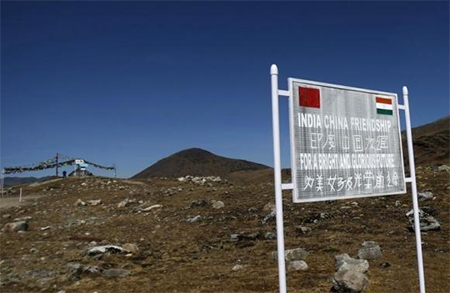 A signboard is seen from the Indian side of the Indo-China border at Bumla, in Arunachal Pradesh, November 11, 2009.