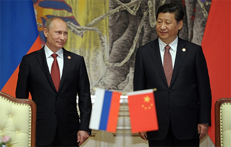 Russian President Vladimir Putin and Chinese President Xi Jinping at a Russia-Chinese documents signing in Shanghai. (Photo by Alexey Druginyn via European Pressphoto Agency)