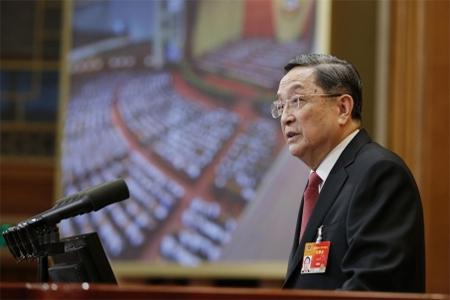 Yu Zhengsheng delivering CPPCC work report. Photo: Xinhua