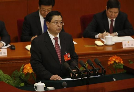 Chairman of the Standing Committee of the National People's Congress (NPC) Zhang Dejiang delivers a work report during a plenary session of the NPC at the Great Hall of the People in Beijing, March 9, 2014.