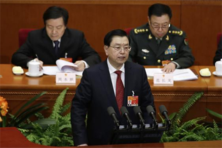 China's parliament chief Zhang Dejiang delivers a work report during the second plenary session of China's parliament, the National People's Congress, at the Great Hall of the People in Beijing, March 8, 2015.