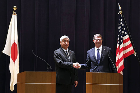 U.S. Defense Secretary Ash Carter, right, and Japan's Defense Minister Gen Nakatani shake hands after their news conference at the Defense Ministry in Tokyo on April 8, 2015.